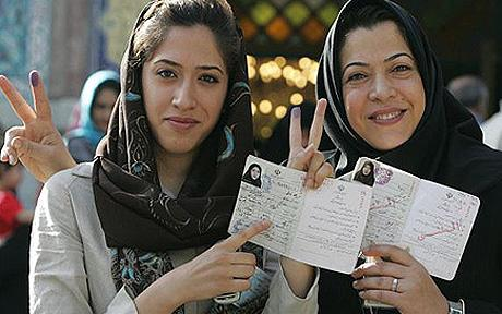 Iranian women shows the ink on their fingers after voting at a polling station in Tehran on June 12, 2009.  Hundreds of voters were standing outside one of the biggest polling stations in uptown Tehran, an indication of a high voter turnout in the early hours of the presidential election in Iran. AFP PHOTO/ATTA KENARE (Photo credit should read ATTA KENARE/AFP/Getty Images)